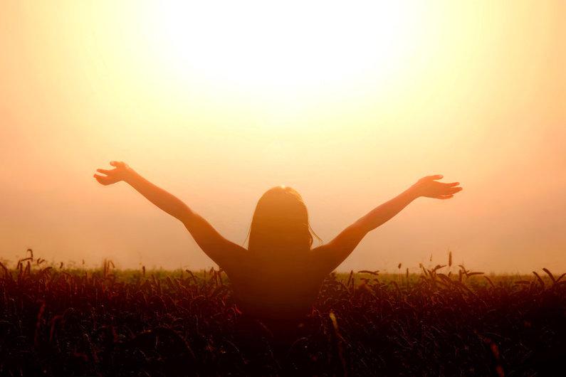 Vrouw zonsondergang